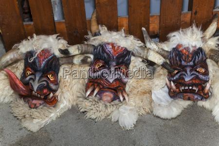 handcrafted wooden krampus masks