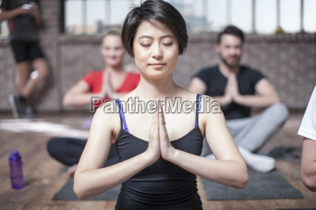 young woman doing yoga meditaiton exercise