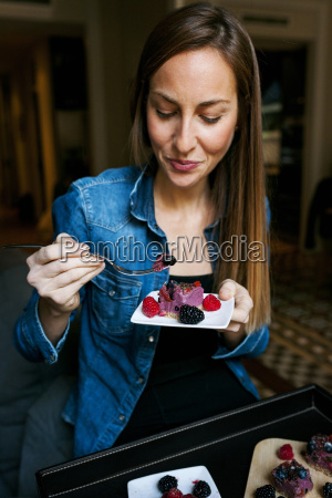 young woman enjoying a healthy dessert