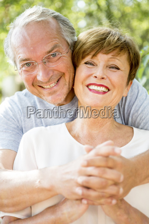 portrait of happy senior couple outdoors