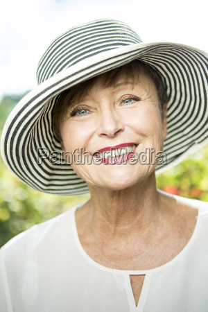 portrait of smiling senior woman wearing