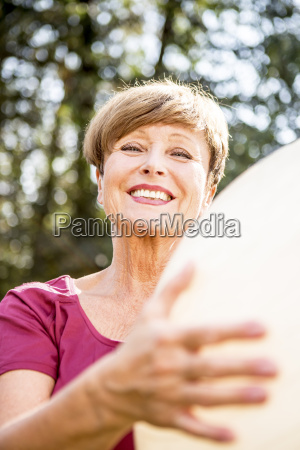 portrait of smiling senior woman holding