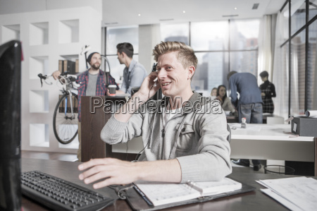young man at desk in office