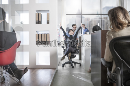 playful colleagues having fun in office