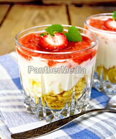 dessert milk with strawberry in glassful