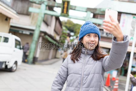 woman taking selfie in japan