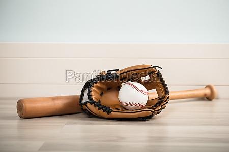 an baseball equipment on floor