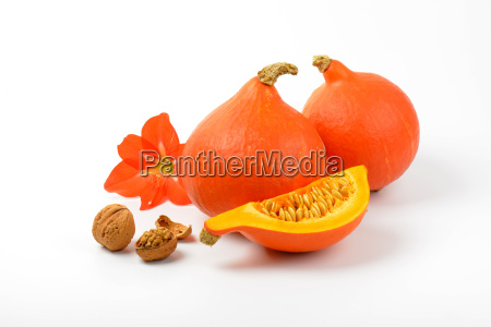 orange pumpkins with walnuts and hibiscus