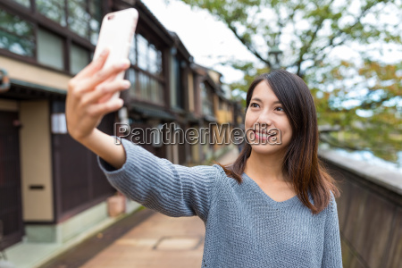 woman taking selfie in kanazawa city
