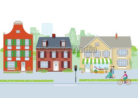 ruhige vorstadtstrasse mit fussgaenger und radfahrer