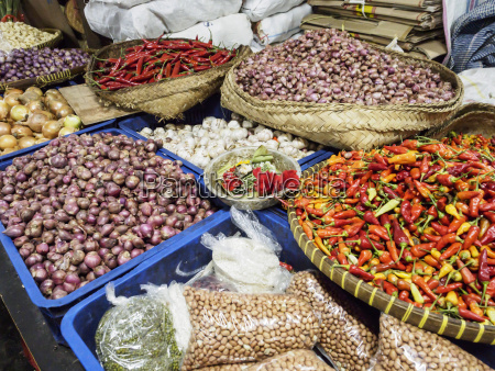 colourful produce of peppers garlic onions