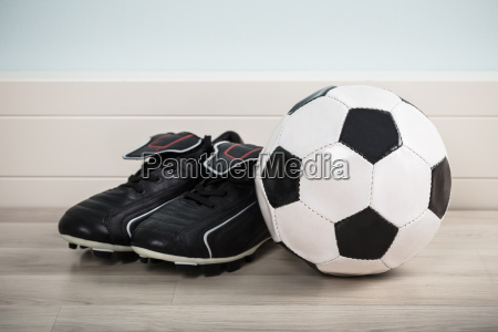pair of shoes with football