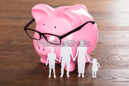 family saving concept on wooden desk