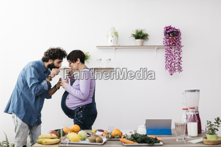 couple drinking glass of healthy fruit