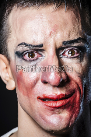 portrait of crying man with smeared