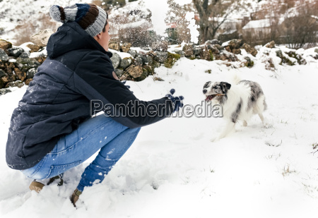 young man playing with his dog