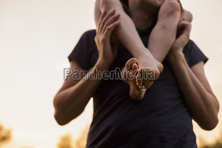 close up of father carrying his