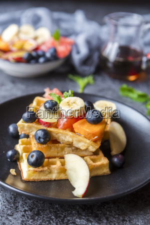 waffles with various fruits and maple