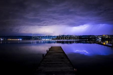 italy thunderstorm at a lake at