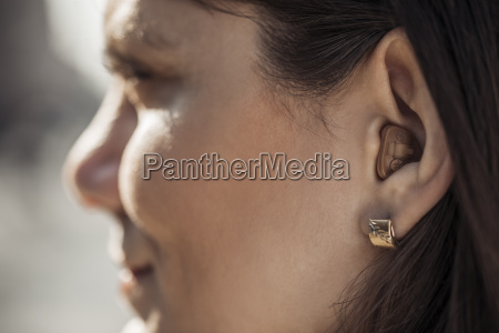 young woman with hearing aid close
