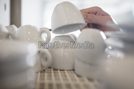 hand taking espresso cup