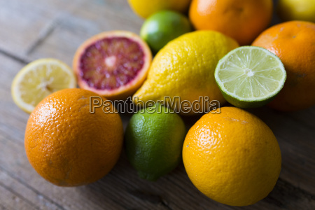 sliced and whole limes oranges and