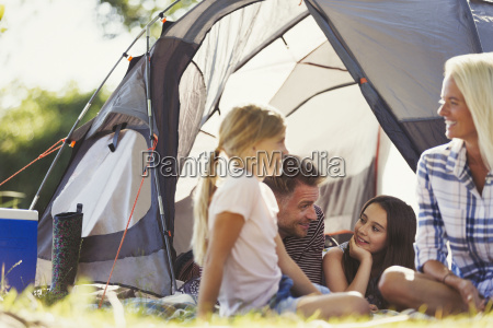 smiling family talking and relaxing outside