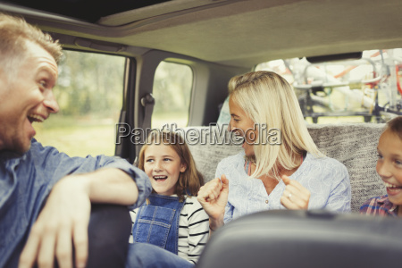 playful family laughing and singing in
