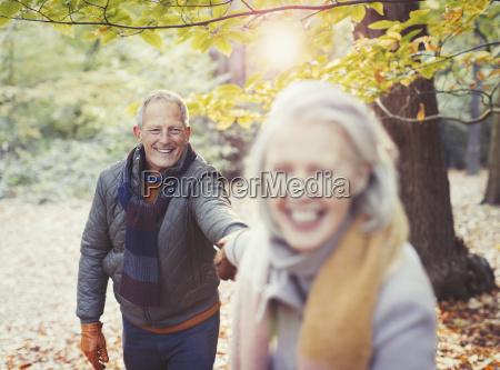 playful senior couple holding hands in