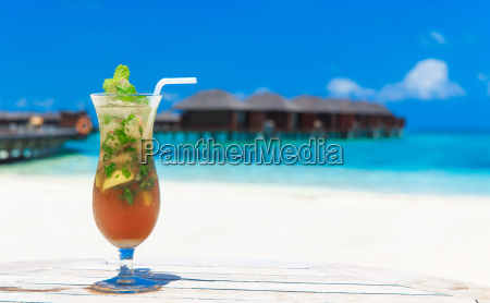 cocktail with blur beach on background