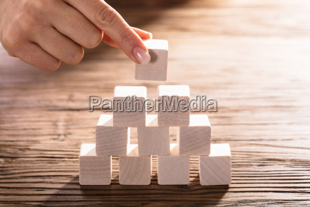 woman placing block on desk