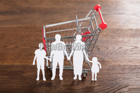 family paper cut with shopping cart