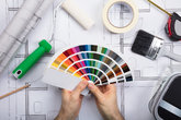 an architect holding color guide swatch