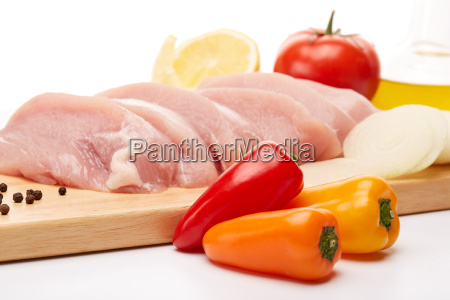 raw turkey meat fillet and vegetables