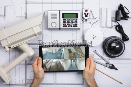 person watching footage on digital tablet