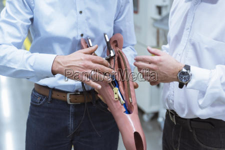 two managers discussing construction of an