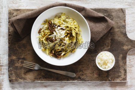 tagliatelle made of carrots with poppy