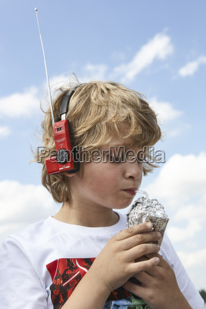 portrait of boy drinking beverage dressed