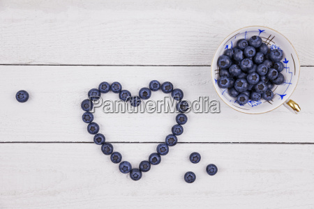 collectors cup of blueberries and heart