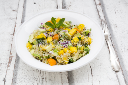 plate of quinoa salad with mango