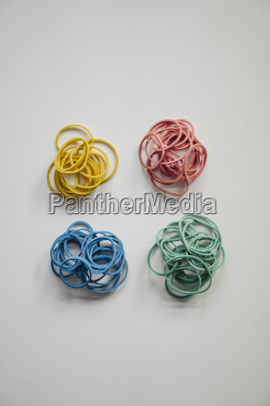 piles of multicolored rubber bands