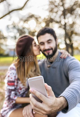 couple taking selfie with smartphone in