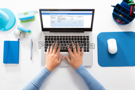 woman doing online banking on laptop