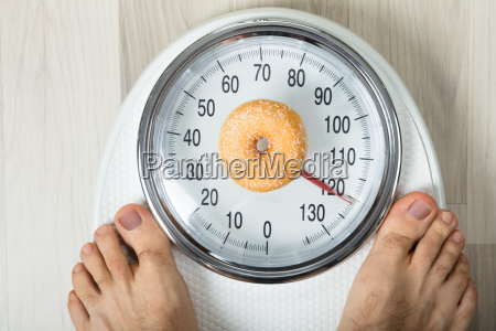 donut and a person on weighing