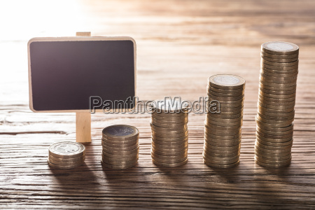 blank small chalk board with coin