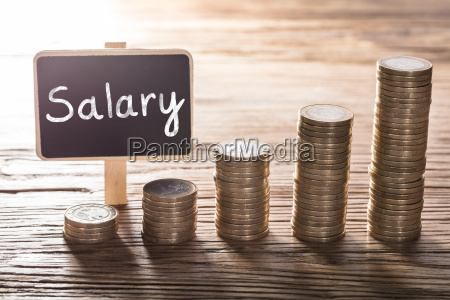 salary text on small chalk board