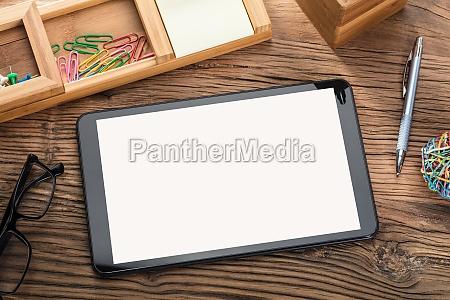 digital tablet on wooden table