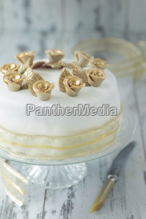 a white festive cake with gold