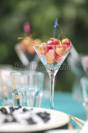 a glass of cherries on a
