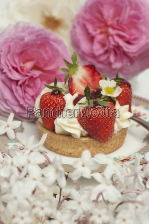 strawberry cake with cream surrounded by